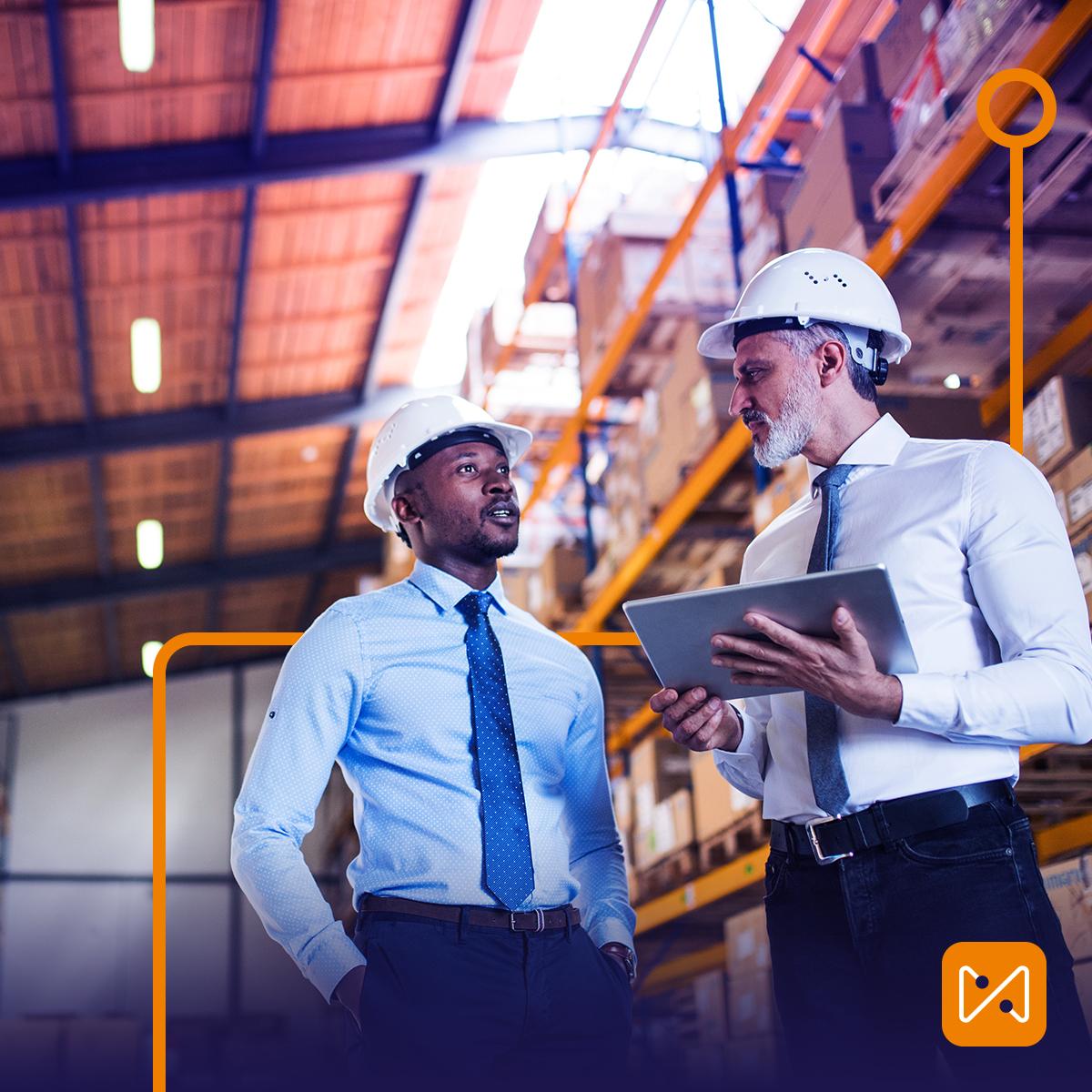 Men talking in warehouse
